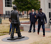 Oxford, MS 11/11/19 Journalist Sol B. River who is doing the documentary about James Meredith is seen flipping off the photojournalist during a break in filming behind the Lyceum on the campus of Ole Miss.  James Meredith, the first African American to attend Ole Miss, is on campus shooting a documentary. Meredith is seen standing and sitting by the statue of himself on the campus of the University of Mississippi right behind the Lyceum building. Meredith has never been a fan of the statute and even asked it be removed and destroyed when it was first installed. James is pictured with Cellas Hayes a freshman who is featured in a new video about Ole Miss.  Photo copyright ©SuziAltman
