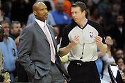March 29, 2010; Cleveland, OH, USA; Cleveland Cavaliers head coach Byron Scott reacts to a call from referee Ed Malloy (14) during the fourth quarter against the Miami Heat at Quicken Loans Arena. The Cavaliers beat the Heat 102-90. Mandatory Credit: Jason Miller-US PRESSWIRE