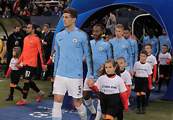 October 23, 2018 - Kharkiv, Ukraine - Defender John Stones of Manchester City FC leads a boy onto the pitch before the UEFA Champions League Group F Matchday 3 game against FC Shakhtar Donetsk at the Metalist Stadium Regional Sports Complex, Kharkiv, northeastern Ukraine, October 23, 2018. Ukrinform. (Credit Image: © Vyacheslav Madiyevskyy/Ukrinform via ZUMA Wire)