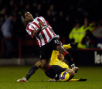 Photo: Jed Wee.<br />Sheffield United v Arsenal. The Barclays Premiership. 30/12/2006.<br /><br />Sheffield United's Mikele Leigertwood is hacked down from behind by Arsenal's Tomas Rosicky.