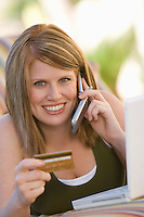 Woman Making Credit Card Purchase