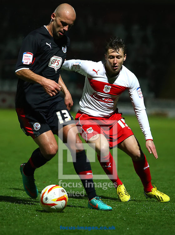 Picture by Rob Fisher/Focus Images Ltd +44 7545 398891.15/12/2012. Luke Freeman of Stevenage and David Hunt of Crawley Town during the npower League 1 match at the Lamex Stadium, Stevenage.