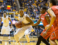 West Virginia Mountaineers guard Daxter Miles Jr. (4) drives down the lane against the Texas Tech Red Raiders during the first half at the WVU Coliseum.