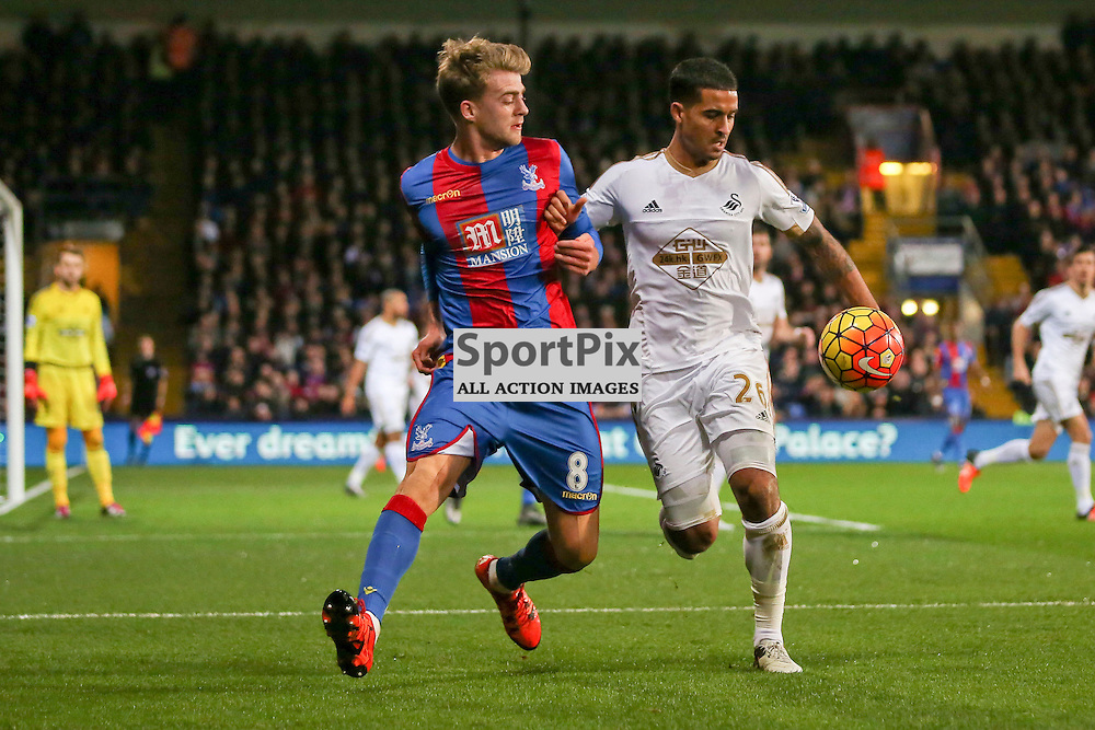 Patrick Bamford of Crystal Palace tussles with Kyle Naughton of Swansea City During Crystal Palace vs Swansea on Monday the 28th December 2015.