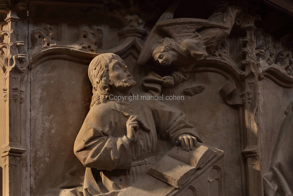 Sculptural detail on one of the two stone pulpits, with an Evangelist at his desk speaking to an angel, in the Cathedral of St Mary, designed by Benito Dalguayre in Catalan Gothic style and begun 1347 on the site of a Romanesque cathedral, consecrated 1447 and completed in 1757, Tortosa, Catalonia, Spain. The cathedral has 3 naves with chapels between the buttresses and an ambulatory with radial chapels. Picture by Manuel Cohen