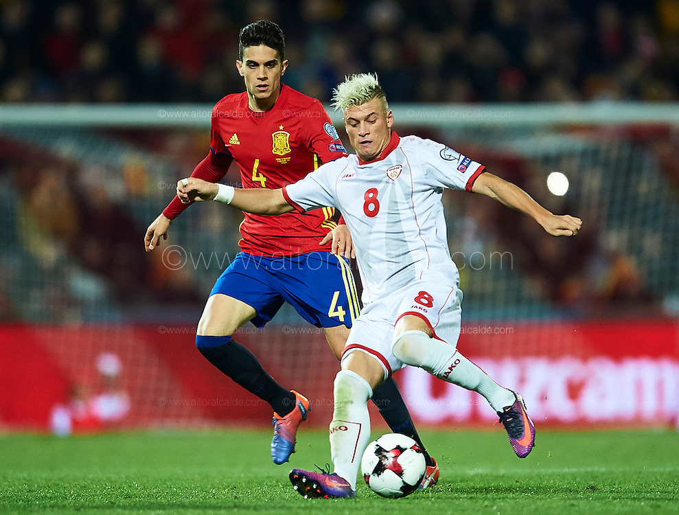 GRANADA, SPAIN - NOVEMBER 12:  Ezgjan Alioski of FYR Macedonia (R) being followed by Marc Bartra of Spain (L) during the FIFA 2018 World Cup Qualifier between Spain and FYR Macedonia at  on November 12, 2016 in Granada, .  (Photo by Aitor Alcalde Colomer/Getty Images)