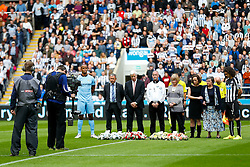 Vincent Kompany of Manchester City and Fabricio Coloccini of Newcastle United stand for a minutes silence with the families of the two Newcastle fans killed in the MH17 air disaster. Liam Sweeney and John Alder were travelling to New Zealand to watch Newcastle play in a pre-season friendly tournament. - Photo mandatory by-line: Rogan Thomson/JMP - 07966 386802 17/08/2014 - SPORT - FOOTBALL - Newcastle, England - St James' Park - Newcastle United v Manchester City - Barclays Premier League.