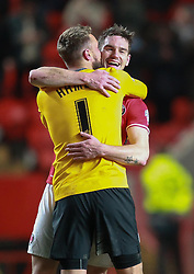Charlton Athletic's Dorian Dervite celebrates scoring with a kiss from Ben Hamer - Photo mandatory by-line: Robin White/JMP - Tel: Mobile: 07966 386802 18/03/2014 - SPORT - FOOTBALL - The Valley - Charlton - Charlton Athletic v Bournemouth - Sky Bet Championship