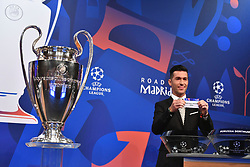 NYON, SWITZERLAND - Monday, December 17, 2018: Former Liverpool player and Champions League winner Luis Garcia holds up Paris Saint-Germain after making the draw during the UEFA Champions League 2018/19 Round of 16 draw at the UEFA House of European Football. (Handout by UEFA)