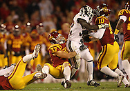 25 OCTOBER 2008: Iowa State defensive back Michael O'Connell (37) pulls down Texas A&M running back Cyrus Gray (32) in the second half of an NCAA college football game between Iowa State and Texas A&M, at Jack Trice Stadium in Ames, Iowa on Saturday Oct. 25, 2008. Texas A&M beat Iowa State 49-35.