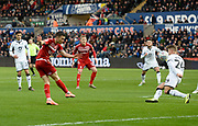 Jonathan Howson (16) of Middlesbrough shoots at goal and its is blocked by Jake Bidwell (24) of Swansea City during the EFL Sky Bet Championship match between Swansea City and Middlesbrough at the Liberty Stadium, Swansea, Wales on 14 December 2019.