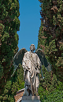 Statue of the angel Gabriel in a cemetery on Isola San Michel, Venice, Italy.