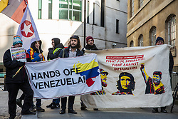 London, UK. 2nd February, 2019. Supporters of the Venezuelan government of Nicolas Máduro attend a protest organised by the Revolutionary Communist Group outside the BBC's Broadcasting House to highlight perceived British media bias in support of Juan Guaidó, the head of the National Venezuelan Assembly who had declared himself interim president of Venezuela the previous week.