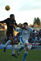 Photo: Ian Hebden.<br /> <br /> Barnet FC v Wycombe Wanderers. Coca Cola League 2. 21/01/2006.<br /> <br /> Barnets Louie Soares (L) beats Wycombes Aidan Collins (L) to the ball.