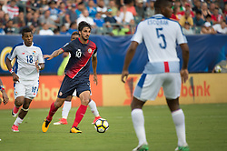 July 19, 2017 - Philadelphia, Pennsylvania, U.S - Costa Rica forward BRYAN RUIZ (10) looks for a pass in the midfield defended by Panama midfielder MIGUEL CAMARGO (18) and Panama defender FIDEL ESCOBAR (5) during CONCACAF Gold Cup 2017 action at Lincoln Financial Field in Philadelphia, PA.  Costa Rica defeats Panama 1 to 0. (Credit Image: © Mark Smith via ZUMA Wire)