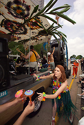 Stock photo of a girl handing out drinks from the tropical band themed car