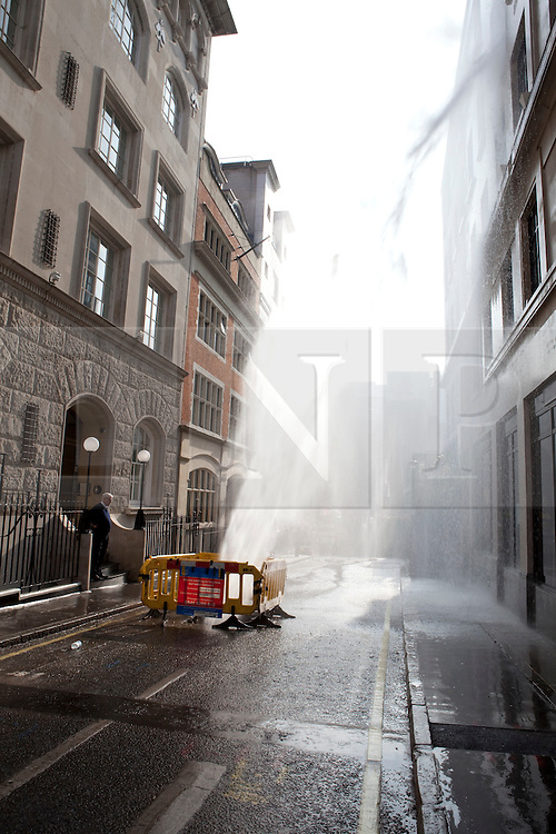 © Licensed to London News Pictures. 01/03/2012. London, U.K..Water Main bursts in Babmaes Street, Piccadilly London SW1 next to Churches shoe shop.Photo credit : Rich Bowen/LNP