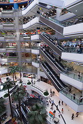 Interior of large modern shopping mall in Guangzhou China