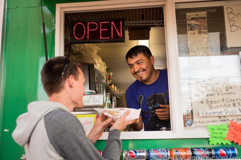 Fernando, owner of Fernando's Alegria food  cart at the Portland Mercado hold fresh veggies that go into the food he makes.