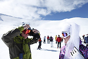 SHOT 2/14/11 12:40:55 PM - Loveland Ski Area in Colorado hosted the 20th Annual Marry Me & Ski Free Mountaintop Matrimony on Valentine's Day Monday, February 14th. The mass wedding ceremony was held at noon at 12,050 feet outside of the Ptarmigan Roost Cabin at Loveland. More than 75 couples were pre-registered to get married or renew their vows high on The Continental Divide in this yearly Loveland tradition.  Following the ceremony couples were invited to a casual reception complete with a champagne toast, wedding cake and music.  (Photo by Marc Piscotty / © 2010)