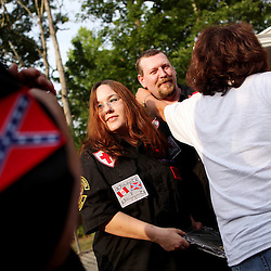 Kyle Green | The Roanoke Times<br /> 7/2/2011 Chris Barker (middle), and his wife receive plaques honoring their service to the KKK before a cross burning with the Rebel Brigade KKK group in Martinsville, Virginia. The KKK is making a comeback in the USA helped by high unemployment and a growing distrust in the government.
