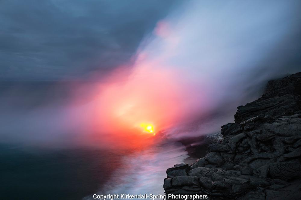 HI00285-00...HAWAI'I -Lava entering the ocean from the Pu'u O'o lava flow in Hawai'i Volcanoes National Park on the island of Hawai'i.
