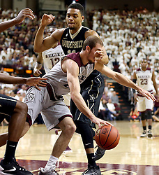 Texas A&M's Alex Caruso (21) runs into Vanderbilt's Jeff Roberson (11) during the first half of an NCAA college basketball game, Saturday, March 5, 2016, in College Station, Texas. Texas A&M won 76-67. (AP Photo/Sam Craft)