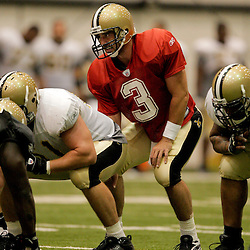 08 August 2009: Quarterback Joey Harrington (3) under center for the offense during the New Orleans Saints annual training camp Black and Gold scrimmage held at the team's indoor practice facility in Metairie, Louisiana.