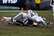 PHILADELPHIA - NOVEMBER 18: The Philadelphia Eagles ball carrier is taken down by two Miami Dolphins on November 18, 2007 at Lincoln Financial Field in Philadelphia, Pennsylvania.