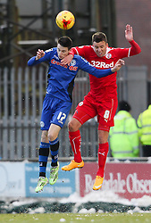 Rochdale's Scott Tanser and Crawley Town's Jimmy Smith challenge for a header - Photo mandatory by-line: Matt McNulty/JMP - Mobile: 07966 386802 - 17.01.2015 - SPORT - Football - Rochdale - Spotland Stadium - Rochdale v Crawley Town - Sky Bet League One
