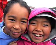 School playground. Coastal Inuit community of Arctic Bay. Lancaster Sound. HIgh Arctic. Baffin Island. .(people, children, kid, girl, boy, teen, cute, playing, class, break ,