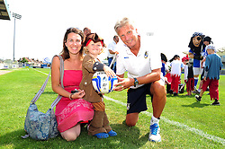 Bristol Rovers Manger, John Ward presents a signed ball to the best dressed pirate - Photo mandatory by-line: Dougie Allward/JMP - Tel: Mobile: 07966 386802 21/07/2013 - SPORT - FOOTBALL - Bristol -  Bristol Rovers Fun Day