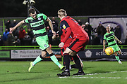 Forest Green Rovers Christian Doidge(9) shoots at goal saved by Grimsby Towns gpoalkeper Sam Russell(23) during the EFL Sky Bet League 2 match between Forest Green Rovers and Grimsby Town FC at the New Lawn, Forest Green, United Kingdom on 22 January 2019.