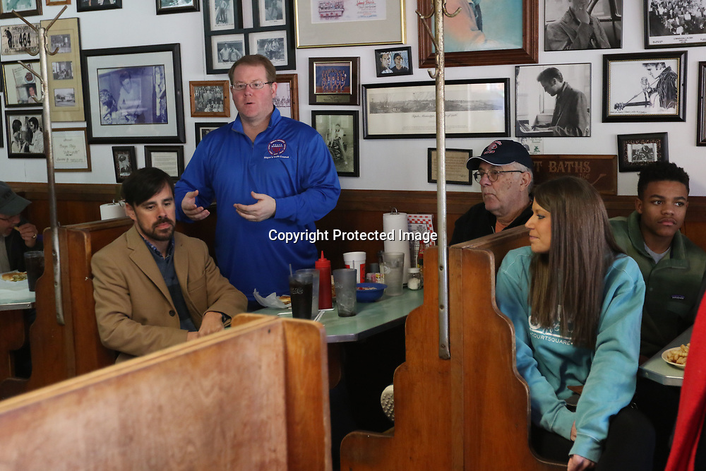 Mayor Jason Shelton met the Mayor's Youth Council at Johnnie's Drive-In Saturday to tell them more about Elvis Presley and was joined by Representative Shane Aguirre, left, and President of the City Council Buddy Palmer, Right