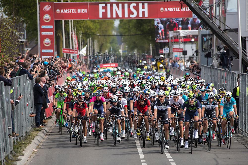 VALKENBURG - wielrennen, 20-04-2014, AMSTEL GOLD RACE, het peloton passeert de finishlijn met o.a. Phllippe Gilbert, tony Martin, Michael Schar, Tom dumoulin, Reinardt Janse van Rensburg