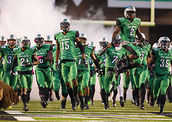 Oct 9, 2015; Huntington, WV, USA; The Marshall Thundering Herd football team runs onto the field before the game against the Southern Miss Golden Eagles at Joan C. Edwards Stadium. Mandatory Credit: Ben Queen-USA TODAY Sports