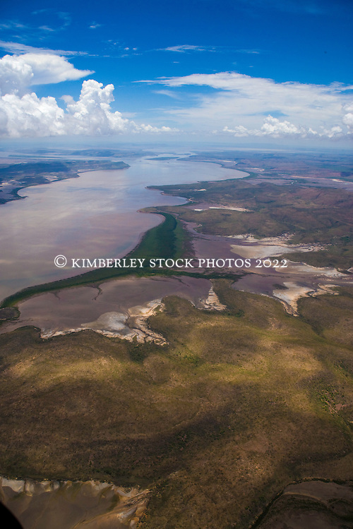 An aerial landscape view of a muddy river near Cambridge Gulf on the east Kimberley coast .