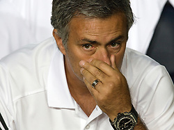 Real Madrid coach Joe Mourinho wipes his nose on the bench before the game.  Barcelona v Real Madrid, Supercopa first leg, Camp Nou, Barcelona, 23rd August 2012...Credit - Eoin Mundow/Cleva Media.