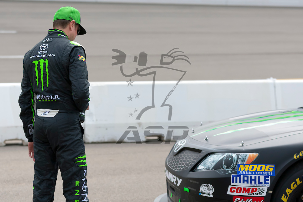 NEWTON, IA - AUG 04, 2012:  Kyle Busch (54) and crew prepare to qualify for the U.S. Cellular 250 at the Iowa Speedway in Newton, IA.