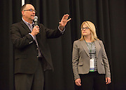 Tim Reynolds, the director of the Robert D. Walter Center for Strategic Leadership, left, and Amy Taylor-Bianco, right, an associate professor in the management systems department in Ohio University's College of Business, talk during the College of Business Center for Leadership Event in Baker Ballroom on April 24, 2016.