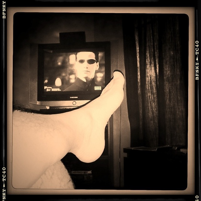 watching TV in bed,crossed feet cellphone photography,Iphone pictures,smartphone pictures
