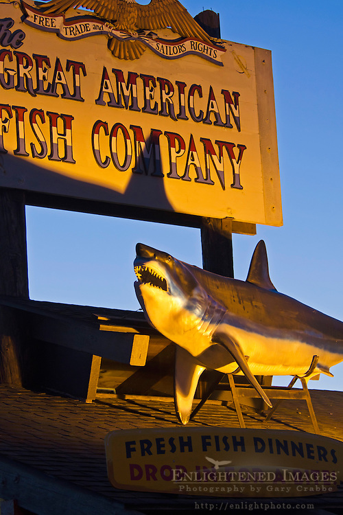 Great White Shark mounted below sign for the Great American Fish Company, along the Embarcadero in Morro Bay, California
