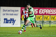 Forest Green Rovers Omar Bugiel(11) runs forward during the 2nd round replay in The FA Cup match between Exeter City and Forest Green Rovers at St James' Park, Exeter, England on 12 December 2017. Photo by Shane Healey.