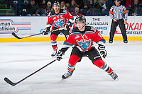 KELOWNA, CANADA - DECEMBER 6: Rourke Chartier #14 of the Kelowna Rockets defends the zone against the Everett Silvertips on December 6, 2013 at Prospera Place in Kelowna, British Columbia, Canada.   (Photo by Marissa Baecker/Shoot the Breeze)  ***  Local Caption  ***