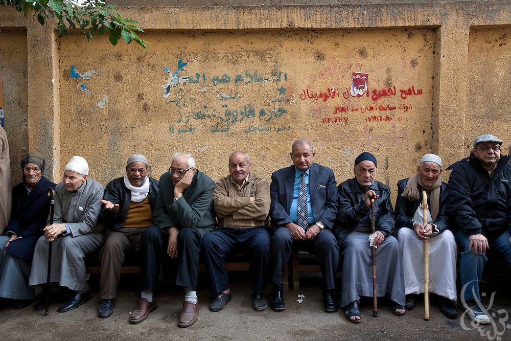 Egyptian voters cue in a line as they wait to take part in historic free parliamentary elections Nov 28, 2011 at a polling station in the Shubra district of the capital, Cairo. The first round of voting (1 of three) for the election, the first since the revolution in Egypt that ousted former president Hosni Mubarak earlier in the year, saw very high voter turnout and is hoped to be a positive step in the direction of a new democratic spirit for the country. (Photo by Scott Nelson)