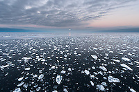 In September 2013 the ice sheet north of Svalbard were at a record 83 degrees north. Only small fragments of ice drifted around under the full mooon. Climate change.