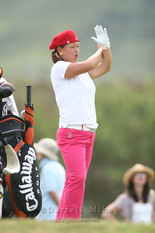 February 18, 2006; Kahuku, HI - Christina Kim communicates with a course marshall during the final round of the LPGA SBS Open at Turtle Bay Resort...Mandatory photo credit: Darrell Miho.© Darrell Miho