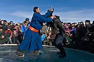 Mongolia. Sumo hand wrestling on ice. during the Ice festival on the frozen Khuvsgul lake. - siberia border - for the mongol new year ,  tsagaan sar, in the cold winter   Khuvsgul province - Mongolia