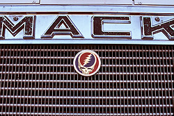 The front grill of a G. D. Productions Mack Truck Cab parked outside the Hampton Coliseum. Scenes before the Second Warlocks Show. The Grateful Dead Live at The Hampton Coliseum 9 October 1989