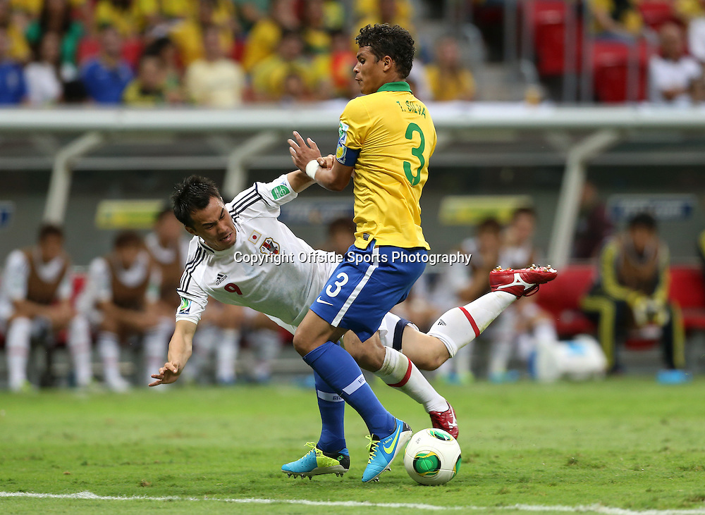 15th June 2013 - FIFA Confederations Cup 2013 - Brazil v Japan - Thiago Silva of Brazil tackles Shinji Okazaki of Japan - Photo: Simon Stacpoole / Offside.